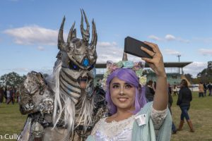 Two people dressed in cosplay take a selfie at Winterfest