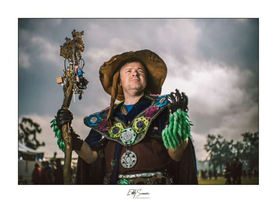 A man wearing fantasy wizard cosplay