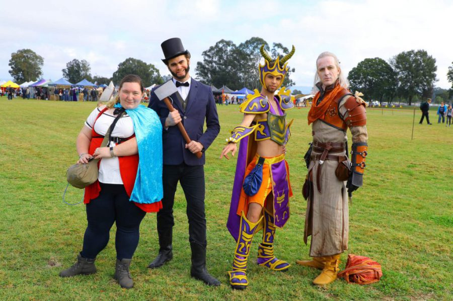 Four cosplayers with different costume styles