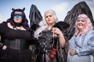 Three women in fantasy costumes at Winterfest