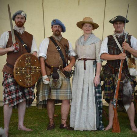 4 Scottish Jacobite reenactors standing together